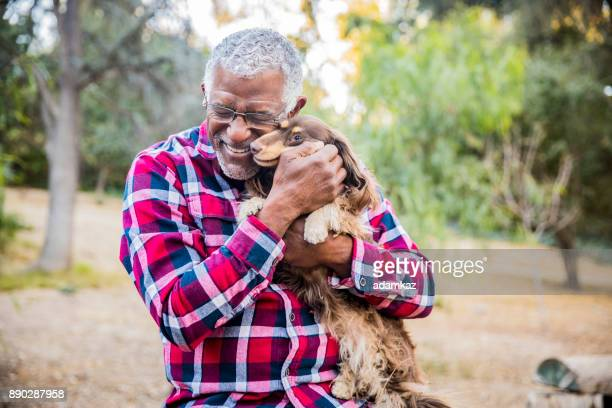 man and his best friend - black people laughing stock photos and pictures