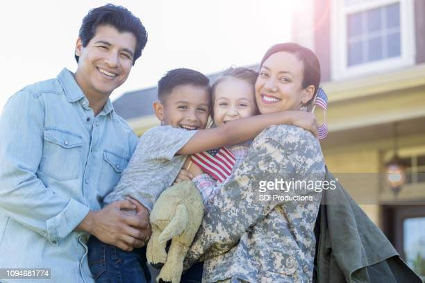 man and his children are reunited with military mom - military stock pictures, royalty-free photos & images
