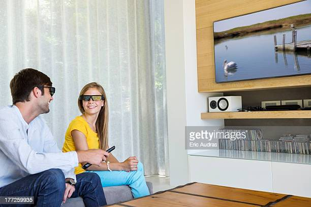 Man and his daughter watching a 3D movie