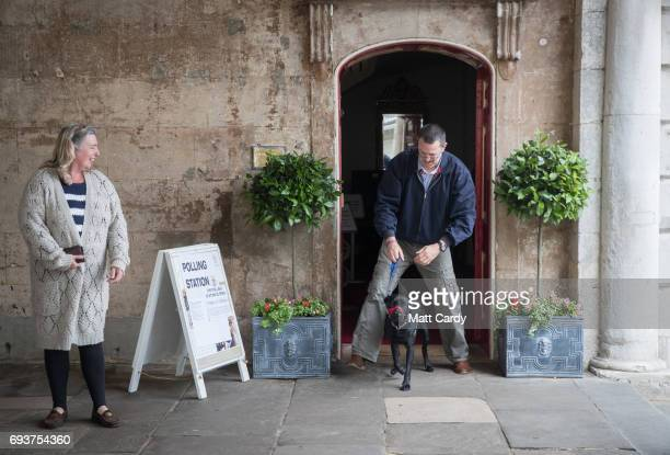A man and his dog leave a polling station in the Windsor Guildhall on June 8 2017 in Windsor United KingdomPolling stations have opened as the nation...