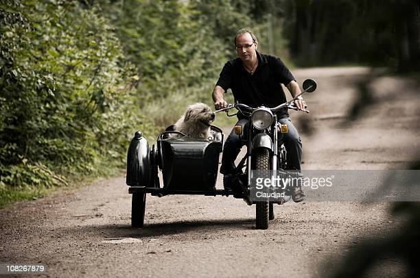 Man and his dog on motorcycle