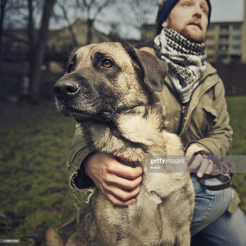 Man and his dog : Stock Photo