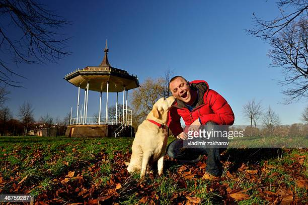 man and his dog - red jacket stock pictures, royalty-free photos & images