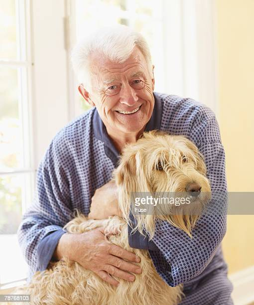 man and his dog - labradoodle stock photos and pictures