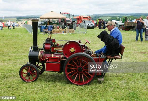 A man and his dog ride a miniature steam engine during the Duncombe Park Steam Rally on July 1 2017 in Helmsley United Kingdom Held annually in the...