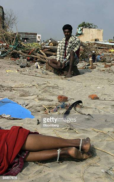 A man and his exhausted sister sleep on the beach in the town of Nagapattinam on India's southeastern coast Wednesday December 29 following a tsunami...