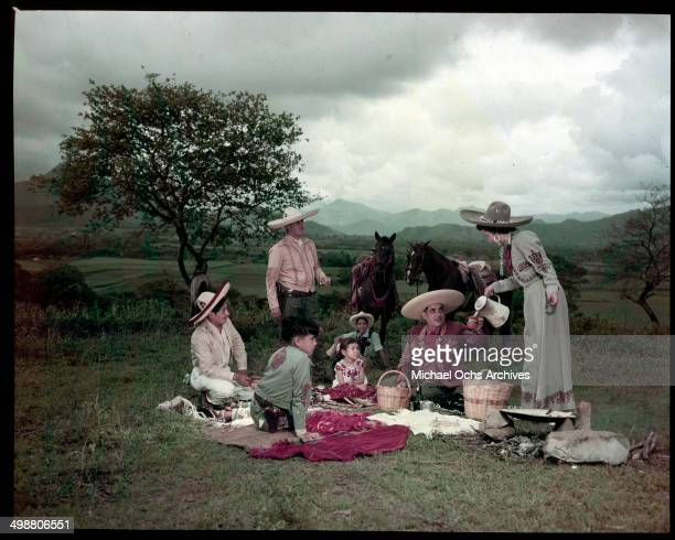 Man and his family dress as a Caballero have a picnic in Acapulco, Mexico in July 1953.