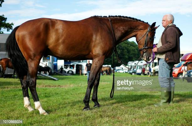 A man and his horse stand together after arriving for 152nd the Ryedale Country Show on July 31 2018 in Kirbymoorside England Held in Welburn Park...