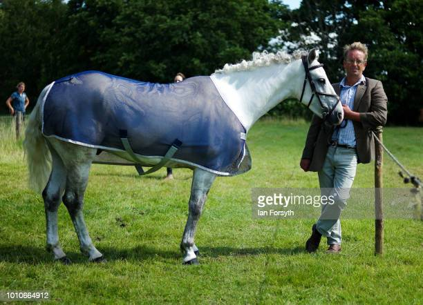 A man and his horse wait at the ringside during 152nd the Ryedale Country Show on July 31 2018 in Kirbymoorside England Held in Welburn Park near...