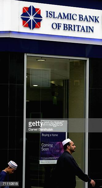 A man and his son walk past the Islamic Bank of Britain on June 2 2006 in London England