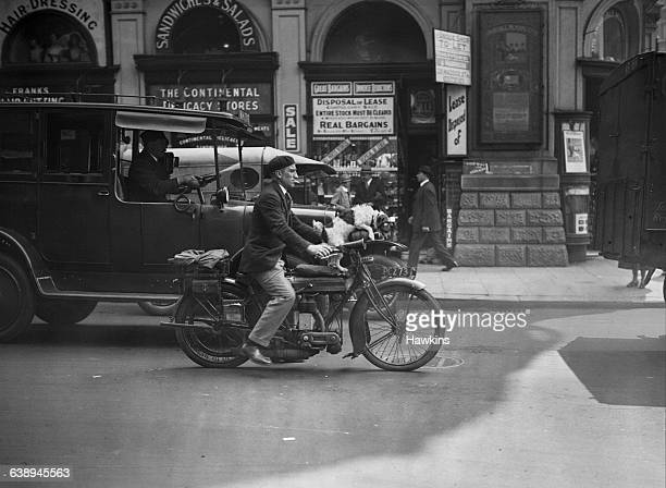 A man and his terrier riding a motorcycle Piccadilly Circus 28th June 1926