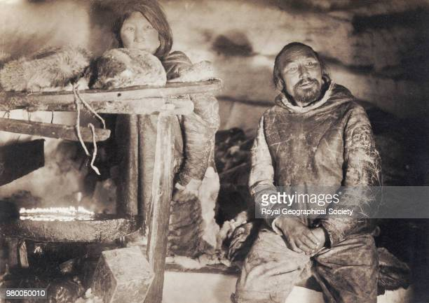 Man and his wife in snow hut Northwest Territories The aim of Amundsen's expedition was to make the first complete journey through the Northwest...
