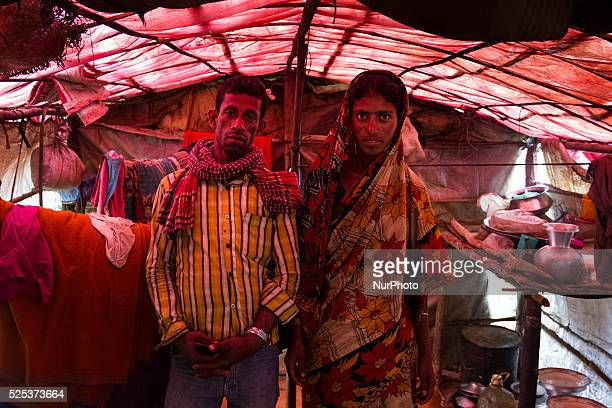 A man and his wife posing for the camera inside their tine house inside stone workers' village on April 4 2015 in Jaflong Sylhet Bangladesh Stone...