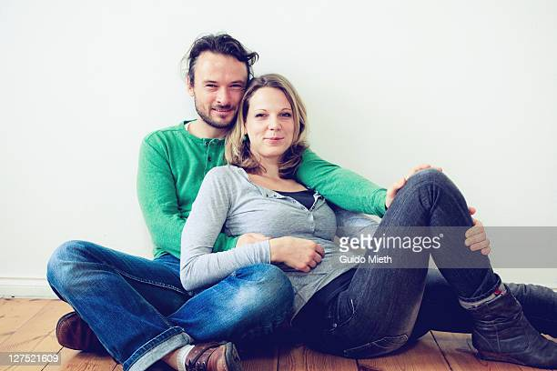 Man and his women sitting close together