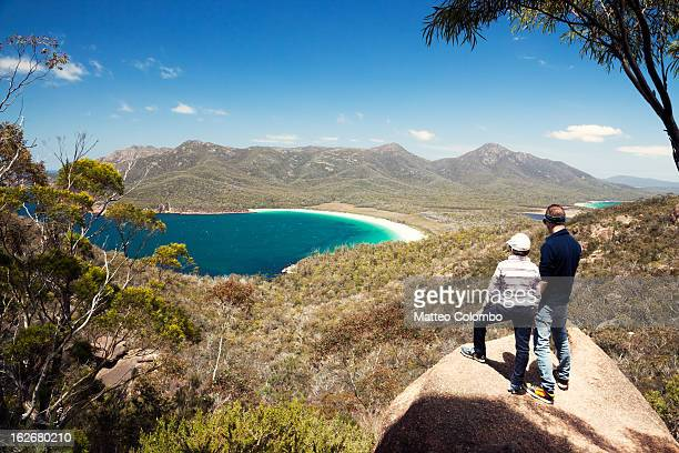 Man and kid looking down to Wineglass bay