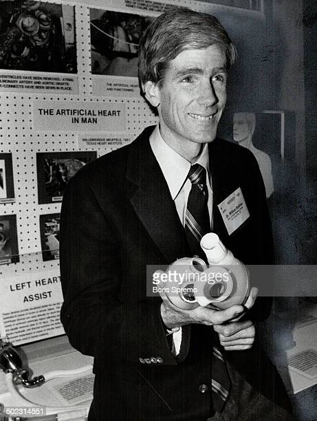 Man and machine Pioneer heart surgeon William DeVries a 39yearold Mormon and father of seven holds a mechanical heart like the one he inserted in...