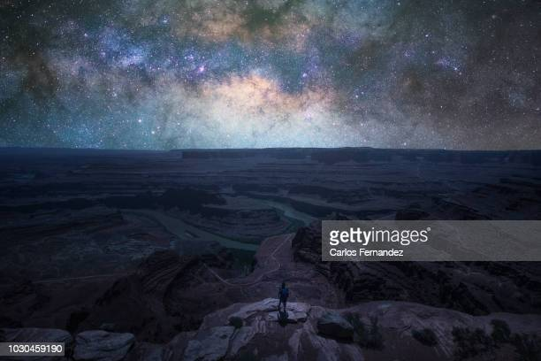 man and milky way - space exploration stock pictures, royalty-free photos & images