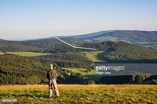 Man and model airplane on Wasserkuppe mountain