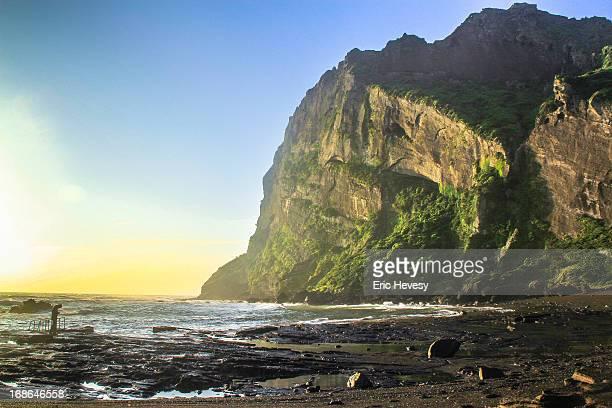 man and peak at sunrise, jeju island - jeju stock-fotos und bilder