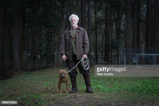 Man and pet dog on lead