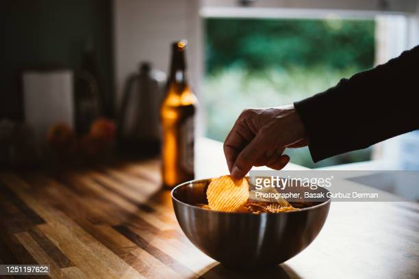 a man and potato chips, beer - freshness stock pictures, royalty-free photos & images