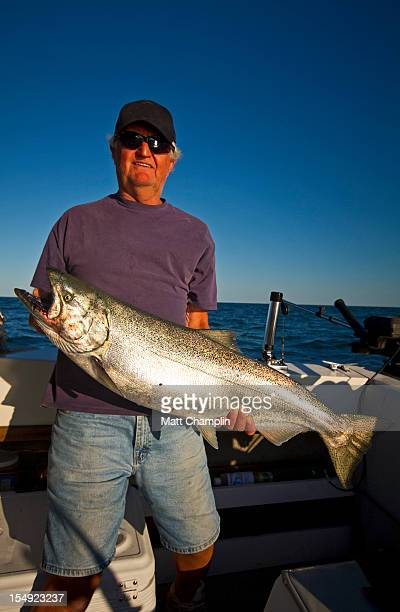 man and salmon - lake ontario stock pictures, royalty-free photos & images