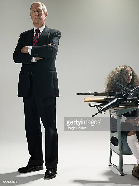 Man and schoolgirl with guns
