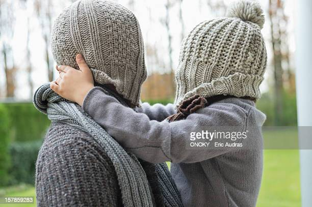 man and son covering their faces with hats - obscured face stock pictures, royalty-free photos & images