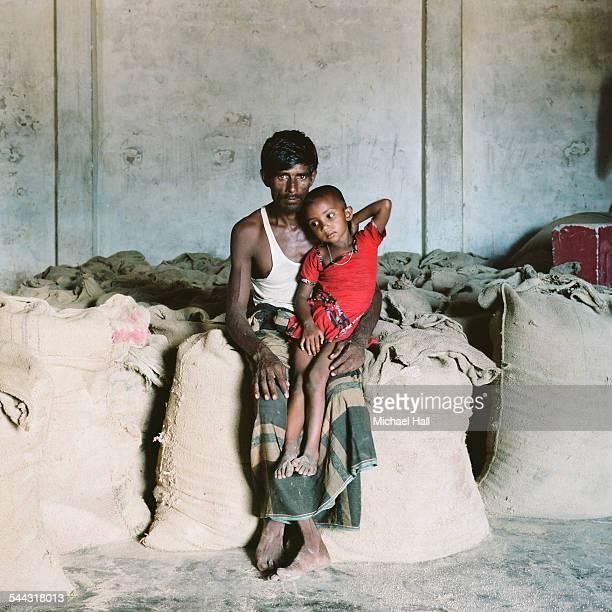 man and son in rice store - bangladesh foto e immagini stock