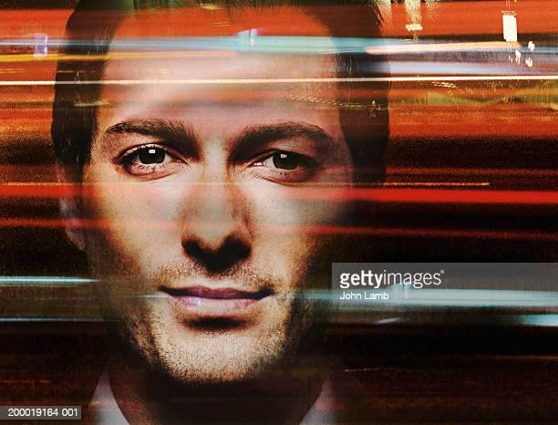 Man and streams of light, portrait, close-up (Digital Composite)