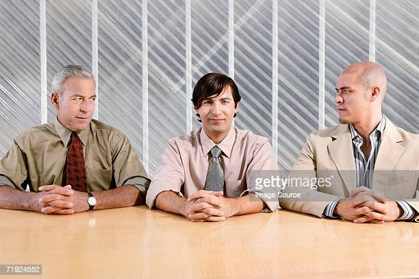 Man and suspicious colleagues