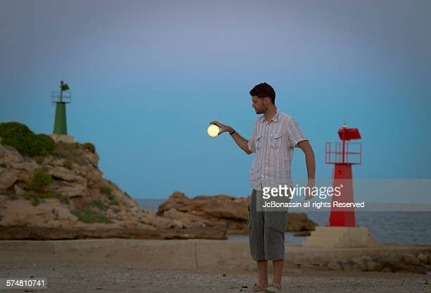 man and the moon in spain - jcbonassin stock-fotos und bilder