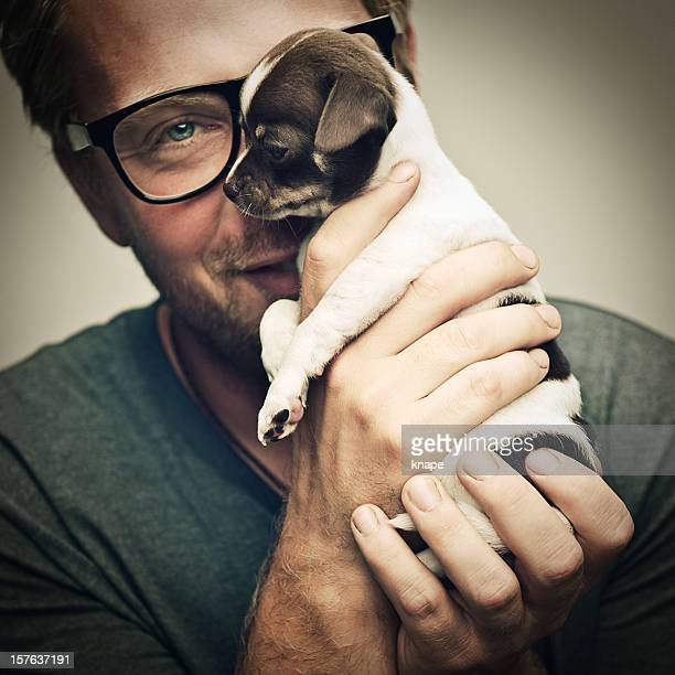 man and tiny chihuahua puppy