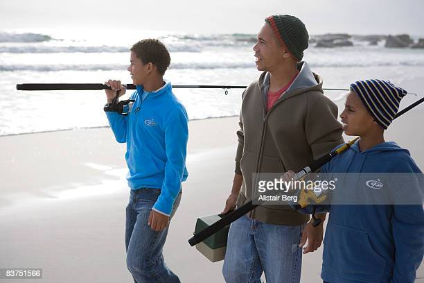 Man and two boys with fishing tackle