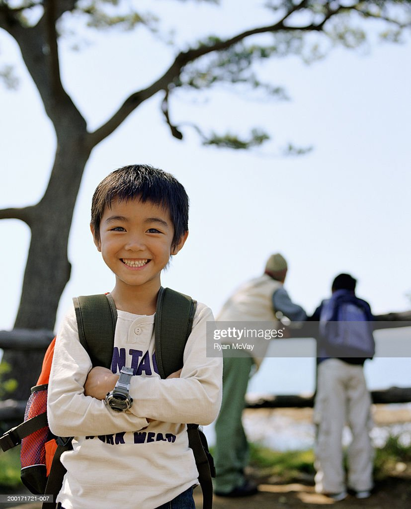 Man and two sons (5-10) outdoors (focus on boy in foreground) : Stock Photo