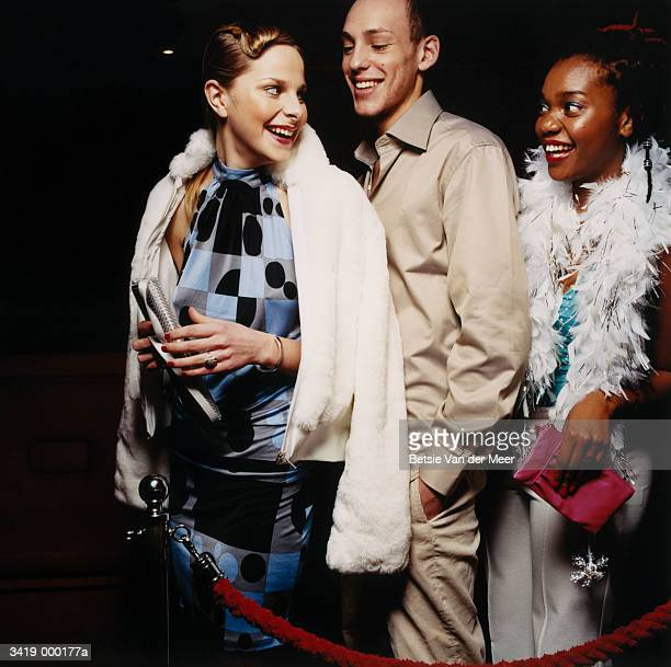 Man and Two Women in Queue