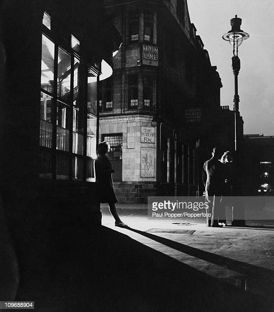 A man and two women outside the Intrepid Fox pub in Soho London 1947