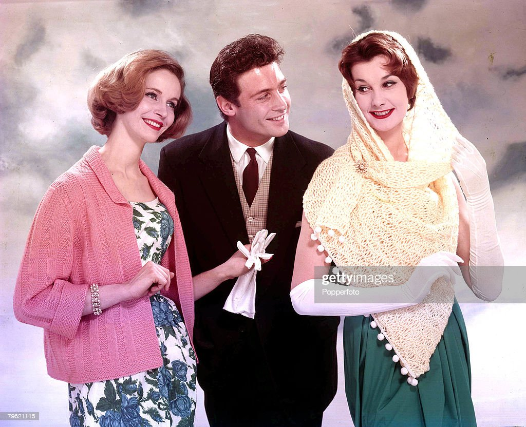 1959 A Man And Two Women Smiling Together One Woman Is Wearing A