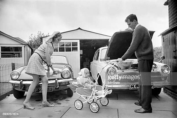 Man and woman and child in a suburban neighbourhood November 1969 Z11174012