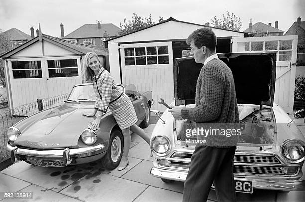Man and woman and child in a suburban neighbourhood November 1969 Z11174003