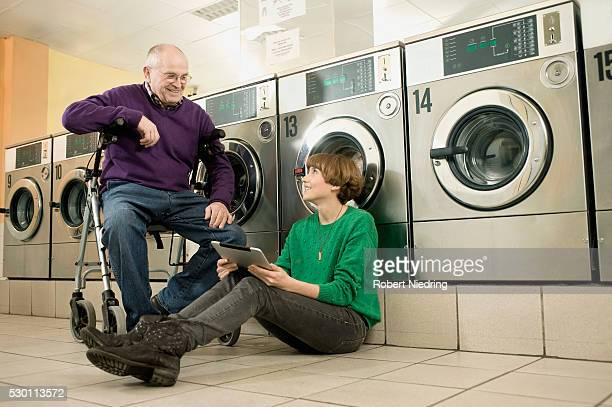 Man and woman are talking in laundry, smiling