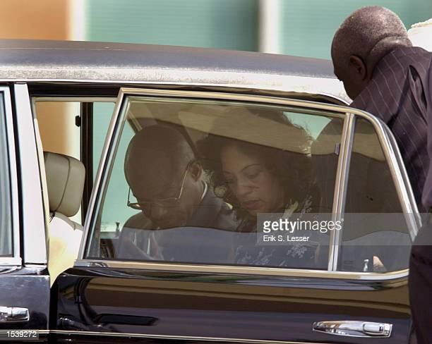 A man and woman arrive for the funeral of singer Lisa Left Eye Lopes at the New Birth Missionary Baptist Church May 2 2002 in Lithonia GA Lopes was...