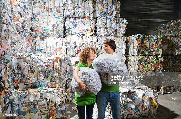 Man and woman at a recycling plant.