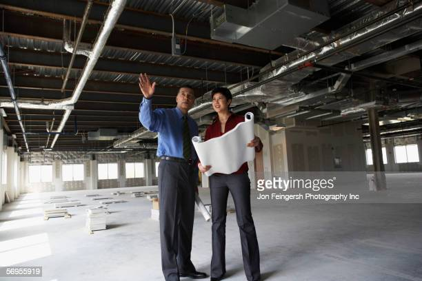 Man and woman at construction site