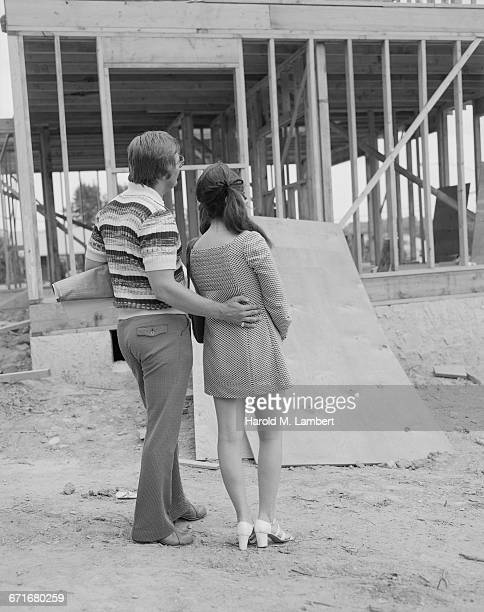 man and woman at construction site - {{relatedsearchurl(carousel.phrase)}} ストックフォトと画像