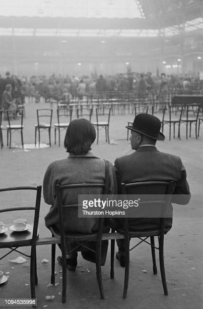 Man and woman at Crufts dog show, held at the Grand Hall, Olympia, London, 8th-9th February 1952. Original Publication: Picture Post - Dog Show -...