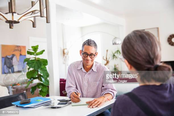 a man and woman at home - printed sleeve stock pictures, royalty-free photos & images