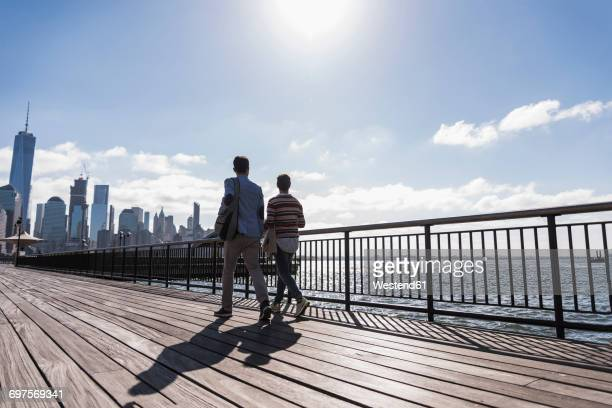 usa, man and woman at new jersey waterfront with view to manhattan - waterfront stock pictures, royalty-free photos & images