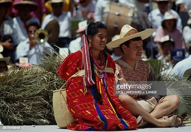 A man and woman at the Guelaguetza festival Oaxaca Mexico