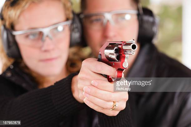 Man and Woman at the Shooting Range